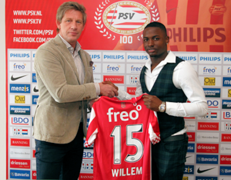 PSV technical director Marcel Brands presents Willems with the no.15 shirt