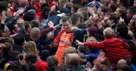 Utrecht keeper Robin Ruiter is mobbed by celebrating fans