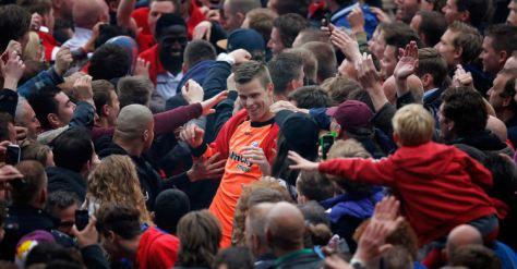Utrecht keeper Robin Ruiter is mobbed by celebrating fans